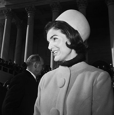 Jackie O wearing a classic 60s pill box hat