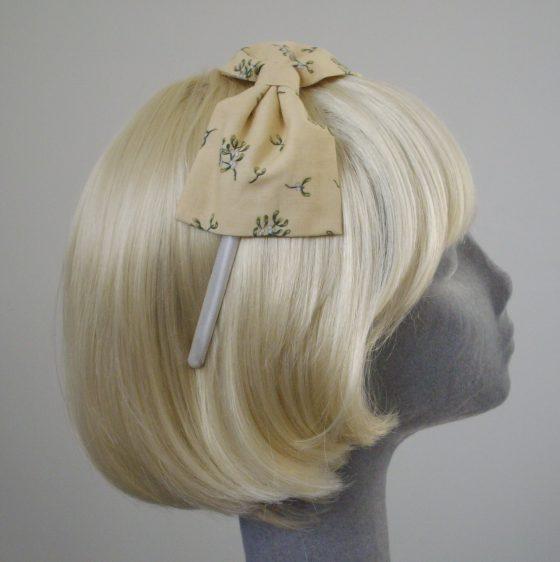 Cream Christmas Mistletoe Bow Headband side