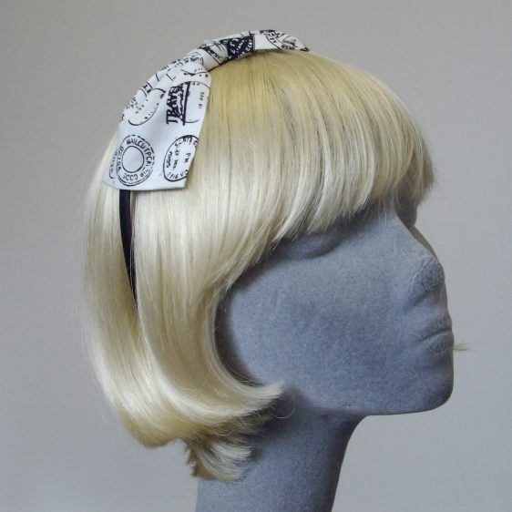 Black Headband with a white and black postmark stamp bow.