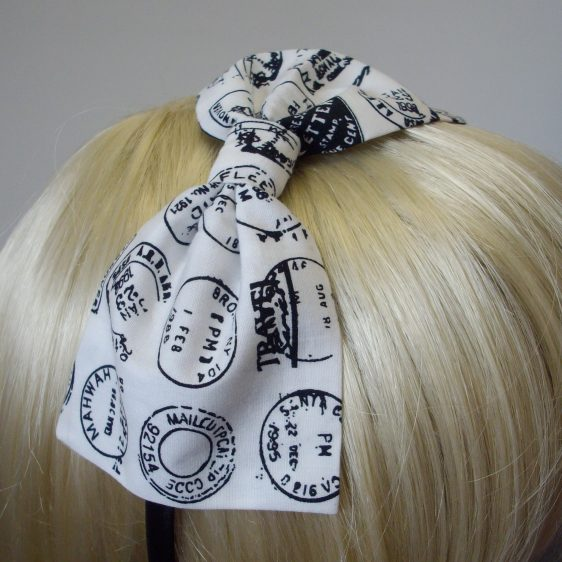 close up of black postmark stamps on a white bow