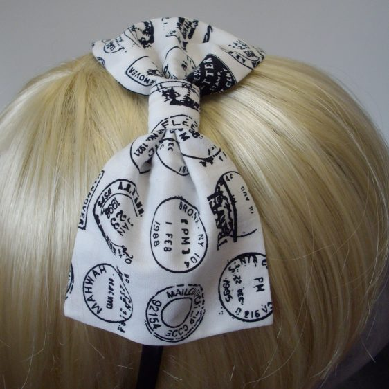 Second close up of a white bow with black postmarks