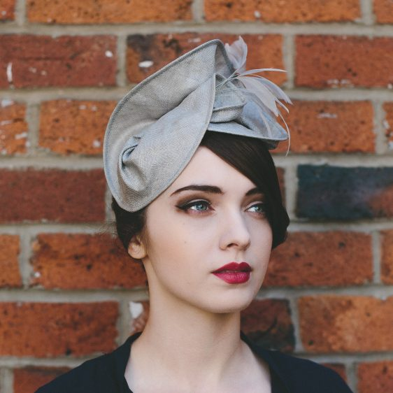 Grey Straw Headpiece with Feathers side