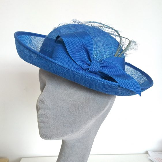 Royal Blue Sinamay Hat with Ribbon Bow and Curled Feathers - angle