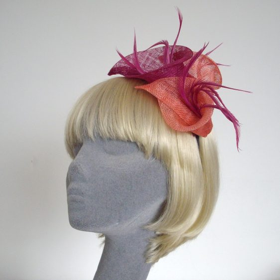 Pink Coral Sinamay Lily and Feather Fascinator - angle