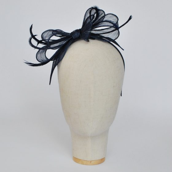 Navy Bow Fascinator with Biot Feathers - front left