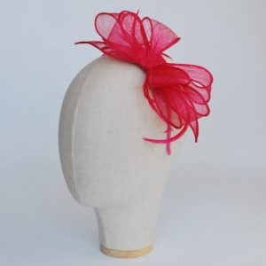 Pink Bow Fascinator with Biot Feathers - angle