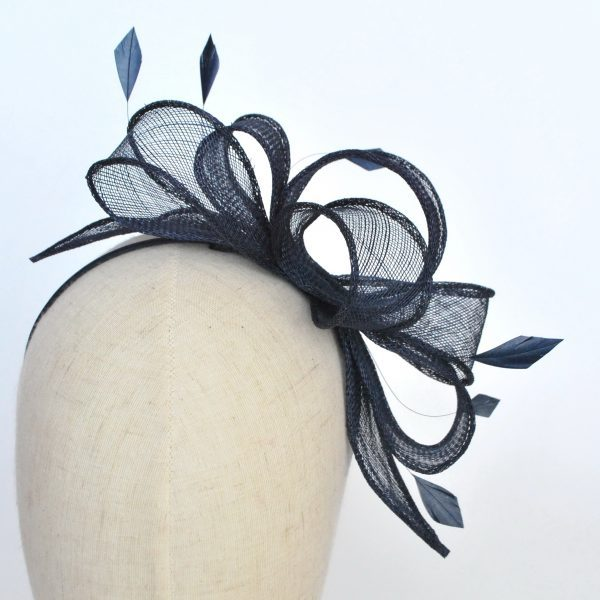 Navy Blue Sinamay Fascinator with Loops and Feathers worn to the left of the head