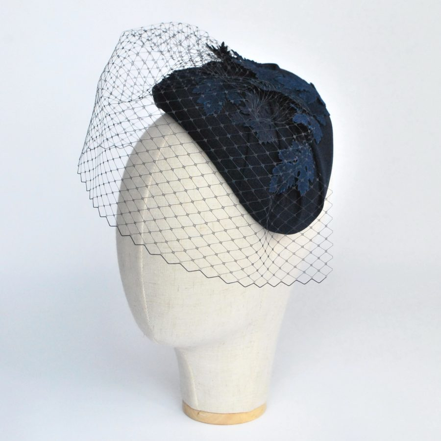 Navy Blue Half Hat with Birdcage Veil and Leather Leaves - angle