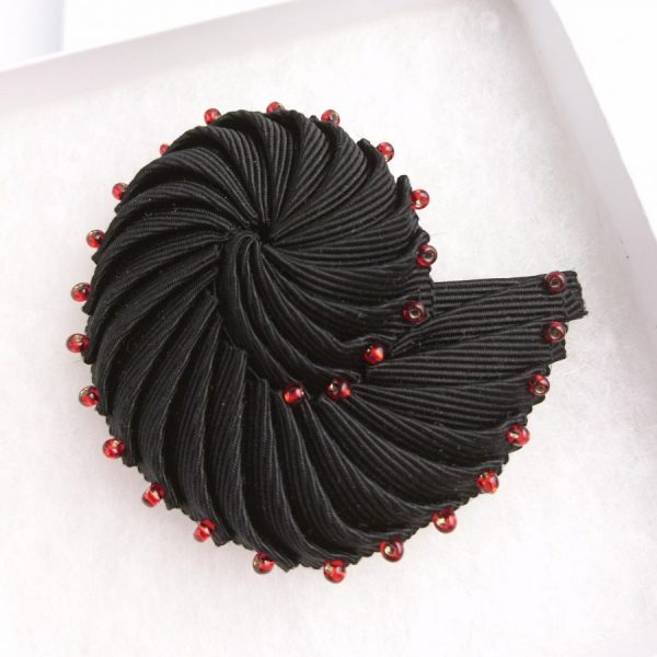 black ribbon brooch with reds beads