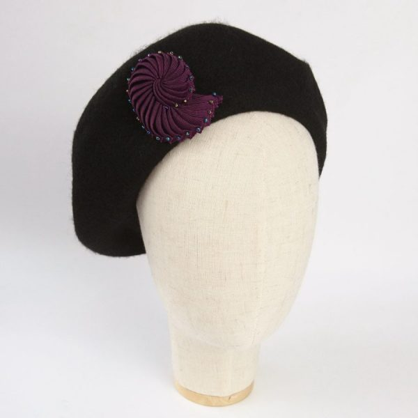 Plum Purple shell brooch worn on a beret