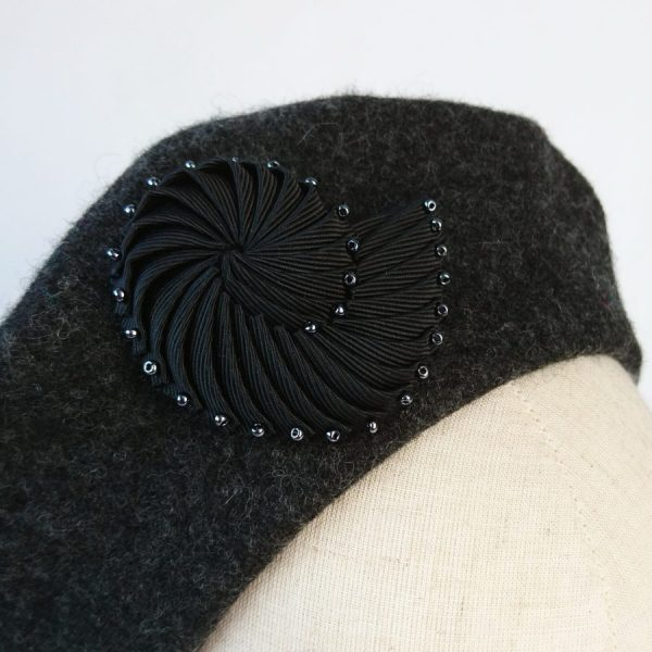 Black Ribbon Shell Brooch with Pewter Beads worn with a beret