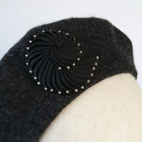 Black Pleated Ribbon Brooch with Silver Beads worn with a beret