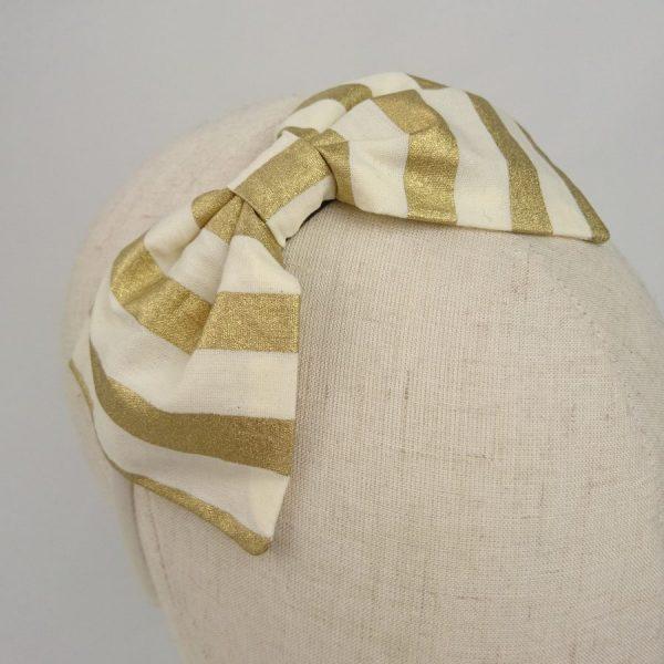 Gold stripe hair bow