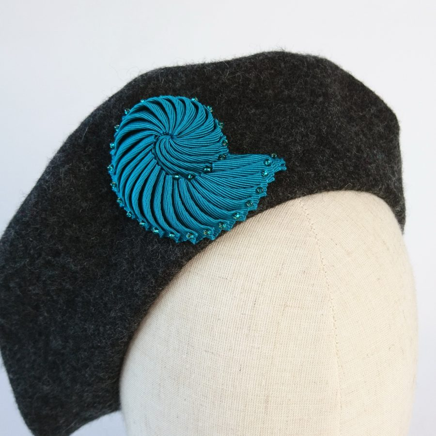 Turquoise Ribbon Shell Brooch with Beads worn with a beret