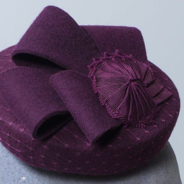 Felt mini button hat with veiling overlay loops and ribbon nautilus shell