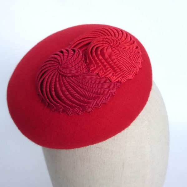 Red hat with pleated ribbon nautilus shells by Imogen's Imagination