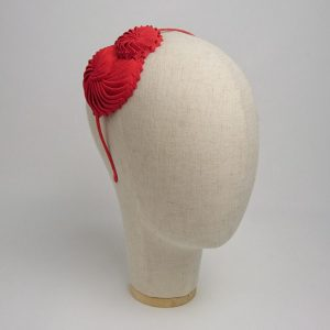 Red Nautilus Shell Headband, angled side view.