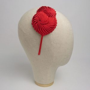 Hair accessories for an autumn or winter wedding unique headband, with red nautilus shell decorations.