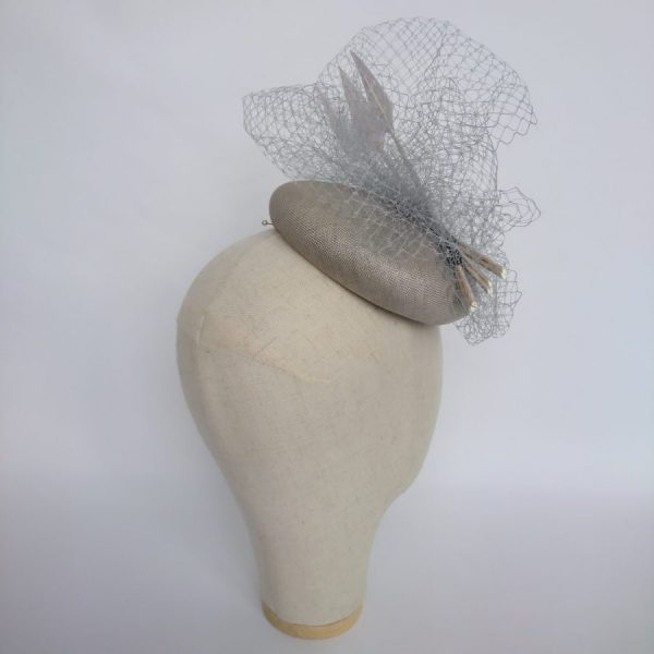 Grey occasion hat with veiling and feathers