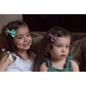 Pink and Green Gift Set Bow Hair Clips worn by sisters
