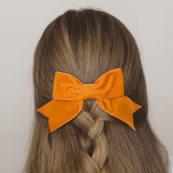 Orange Velvet Hair Bow worn with a braid