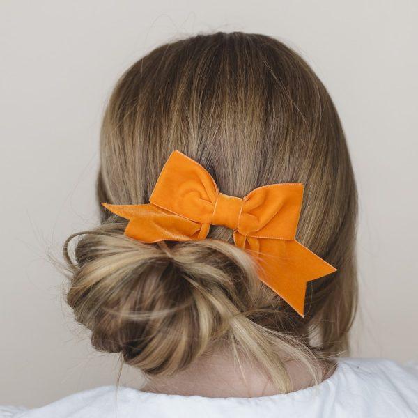 Orange Velvet Hair Bow worn with a bun