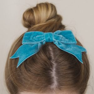 Teal Velvet Hair Bow worn with a bun
