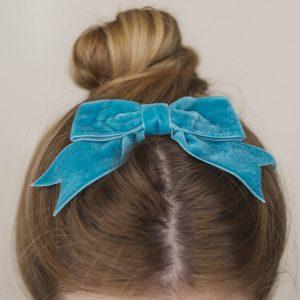 Teal Velvet Hair Bow worn with a bun