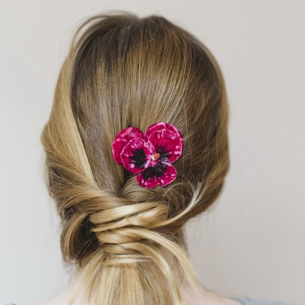 Fuchsia Pansy Flower Hair Clip worn with ponytail