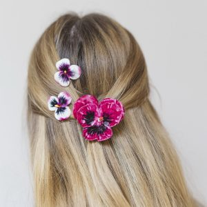 Fuchsia Pansy Hair Clip Gift Set worn with a half up-do hair style