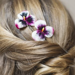 Detail image of Pink White Pansy Flower Hair Clips worn with a twist ponytail