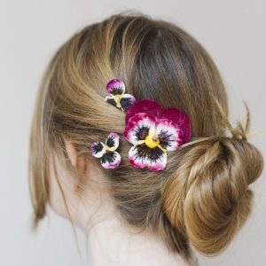 Trio of coordinating Magenta Pansy hair accessories for bridesmaids