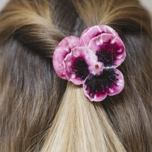 Detail Image of Pink Pansy Flower Hair Clip worn with half up do