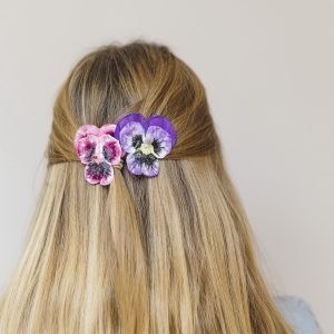 Purple and Pink Large Pansy Flower Gift Set hair clips worn with a half ponytail