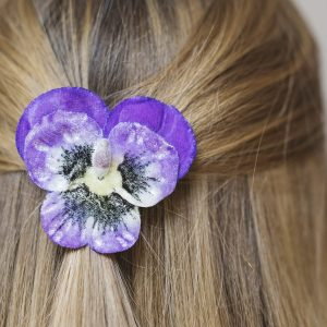 Detail image of Purple Pansy Flower Hair Clip worn with half up do