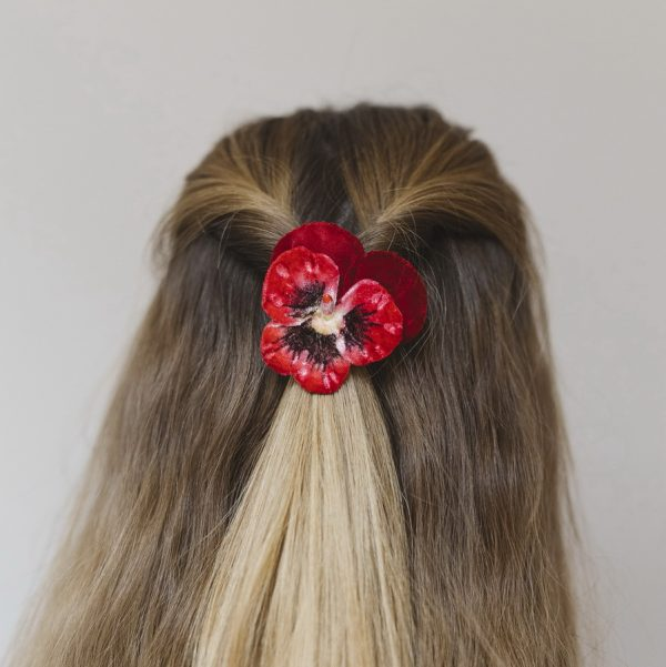 Red Large Pansy Flower Hair Clip worn with a twisted hair style