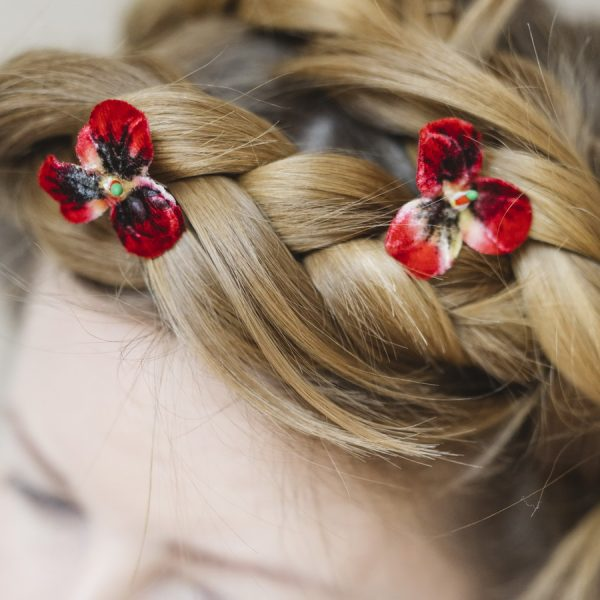Detail image of Small Red Pansy Flower Hair Pins worn with a halo braid