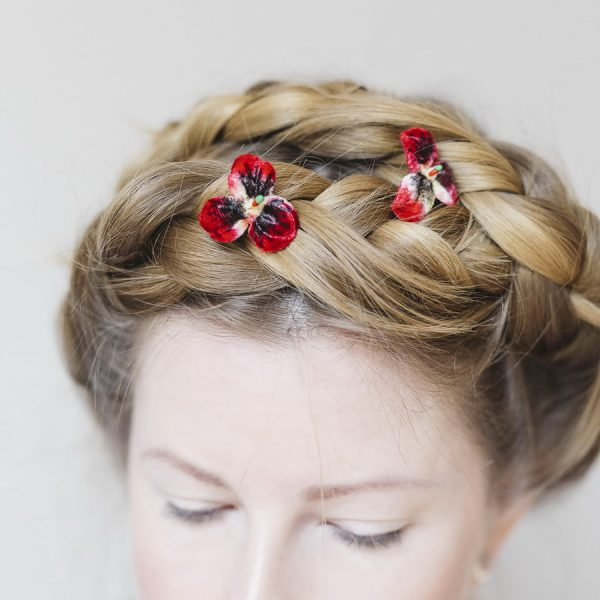 Small Red Pansy Flower Hair Pins worn with a halo braid