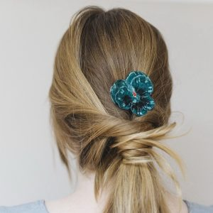 Teal Pansy Flower Hair Clip worn with a ponytail