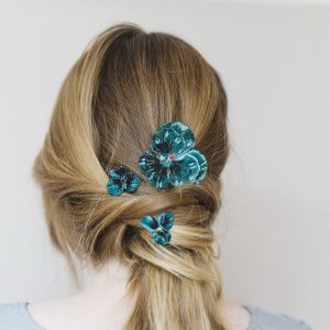 Teal Pansy Hair Clip Gift Set worn with a ponytail