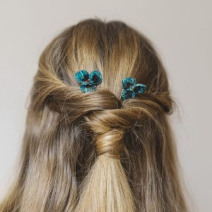 Teal Pansy Flower Hair Clips worn with a twist ponytail