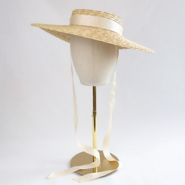 Natural Straw Boater Sun Hat worn with ivory ribbon ties