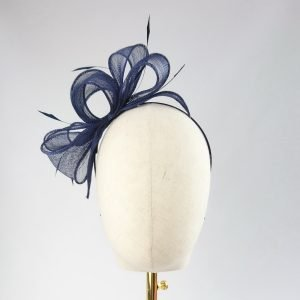 Navy Blue Loop Fascinator with Coque Feathers worn to the right of the head