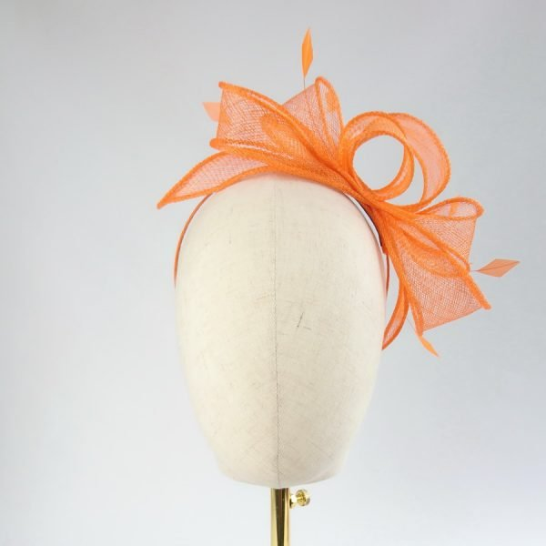 Orange Loop Fascinator with Coque Feathers worn to the left of the head