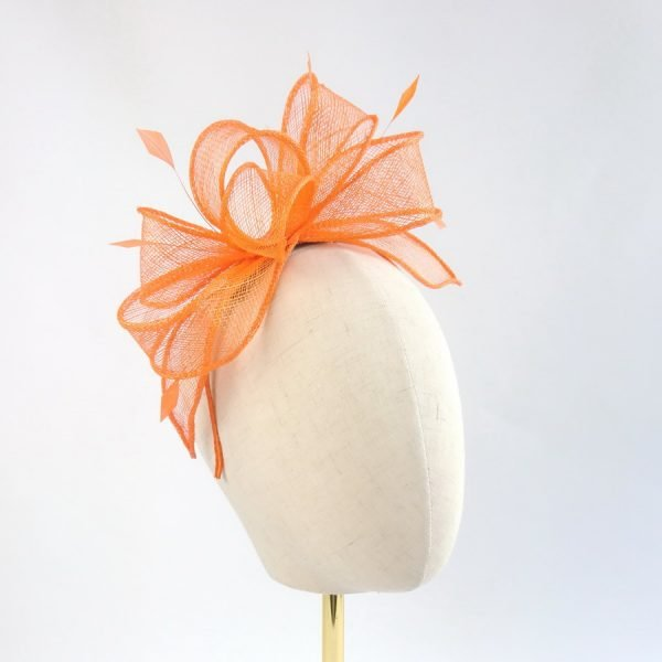Orange Loop Fascinator with Coque Feathers worn to the right of the head