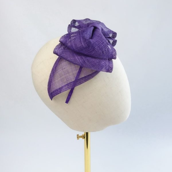 Purple Summer Hair Accessories. Side view of fascinator with large, purple sinamay bow, and satin-covered headband