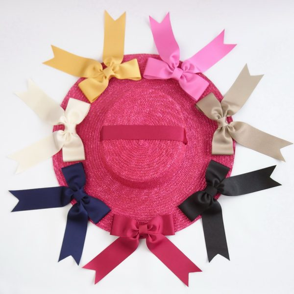 Detachable Ribbon Bows for Sun Hats shown with Red Straw