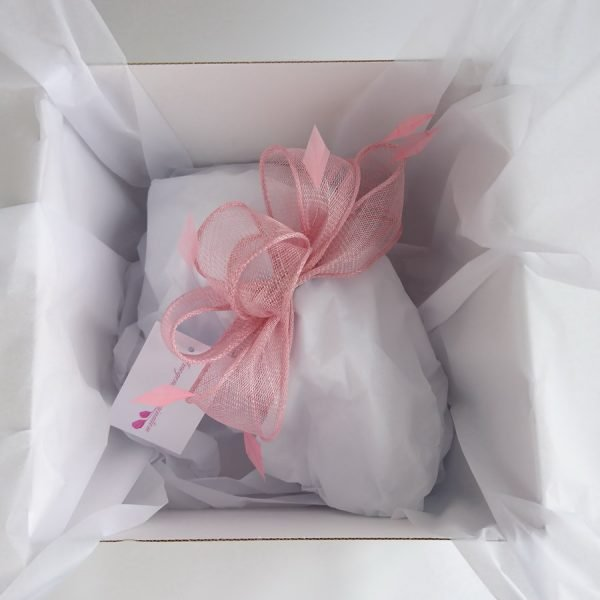 Imogen's Imagination fascinator packed in a hat box with white tissue paper